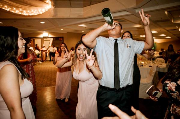 Wedding Budget Hacks - Make Your Own Playlist - Wedding Guests On Dancefloor