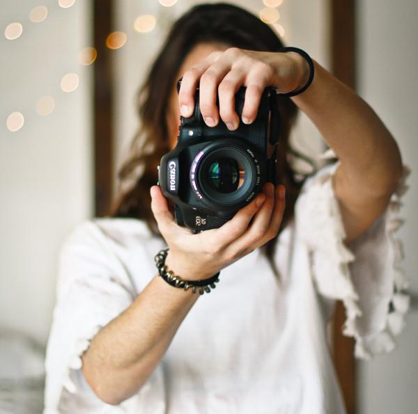 Small Wedding Budget - Friend Photographer - Woman Holding Up A Digital Camera